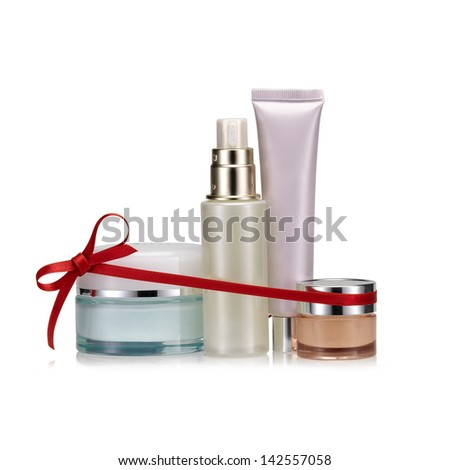 Nameless beauty set gift on white background with a red bow. Christmas present. - stock photo