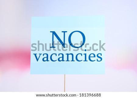 Nameplate with inscription No vacancies on bright background - stock photo
