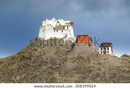 Namgyal Tsemo Gompa (Castle at Tsemo) against the background of cloudy sky - Tibet, Leh district, Ladakh, Himalayas, Jammu and Kashmir, Northern India - stock photo