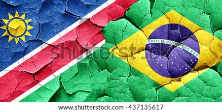 Namibia flag with Brazil flag on a grunge cracked wall