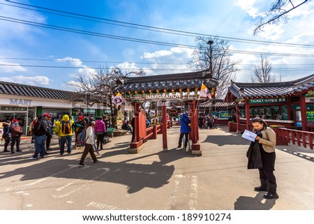 NAMISEOM - March 06: tourists in front of the gate pier to Nami Island March 6, 2014 in Chuncheon, South Korea. - stock photo