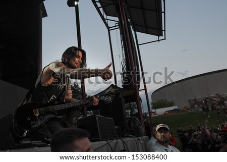 NAMPA, IDAHO - SEPTEMBER 5: After giving his pick to a membe of the crowd Janes Addiction Guitarist Dave Navarro gives a thumbs up at Uproar Festival in Nampa, Idaho September 5th, 2013 - stock photo