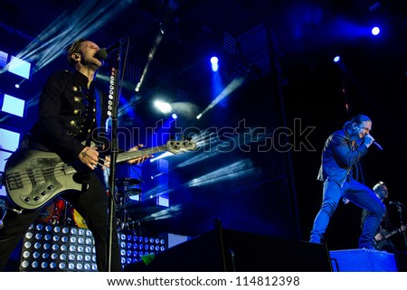 NAMPA, IDAHO - SEPTEMBER 25: Brent Smith and Eric Bass with Shinedown perform live onstage at Rockstar Uproar Festival on September 25 2012 in Nampa, Idaho.