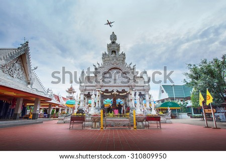 NAN, THAILAND, JULY 31, 2015: Nan city pillar shrine with people respecting to it. - stock photo