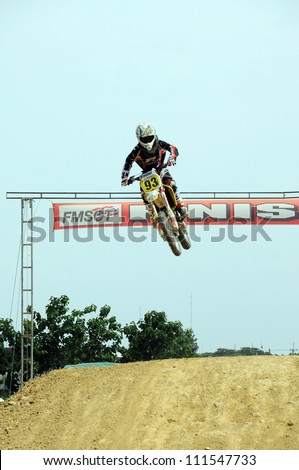 NAN, THAILAND - JUN 03: An unidentified rider participates in the 3rd round (Class C Type) of Motocross 2012 Thailand motocross championship on June 03, 2012 in Nan Province, Thailand.
