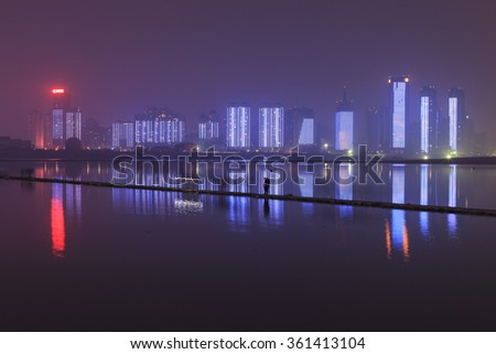 Nanchang, China - January 3, 2016: Nanchang skyline at night as seen from the east side of the city. Nanchang is the capital of Jianxi province in China
