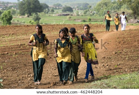 NANDGAON, AMRAVATI, MAHARASHTRA, INDIA - 18 JULY 2015 : unidentified Happy Indian rural school student going to school together from their village to urban area for education.