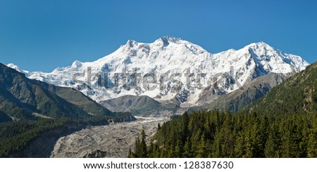Nanga Parbat Panorama. The ninth highest mountain in the world and western anchor of the Himalayas is located in Gilgit-Baltistan, Pakistan. - stock photo