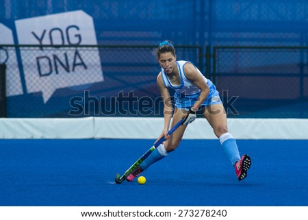 NANJING, CHINA-AUGUST 21: An unidentified player of Uruguay Hockey Team in action on Day 5 match of 2014 Youth Olympic Games on August 21, 2014 in Nanjing, China. Uruguay wins 6-3.