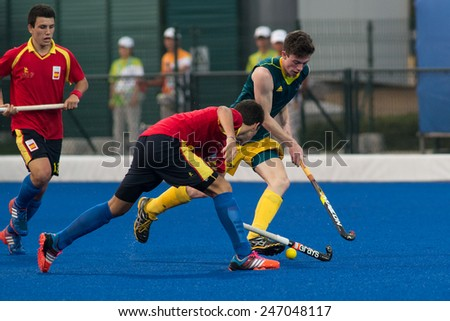 NANJING, CHINA-AUGUST 20: Australia Hockey Team (green) plays against Spain Hockey Team (red) during Day 4 match of 2014 Youth Olympic Games on August 20, 2014 in Nanjing, China. Spain wins 7-6.
