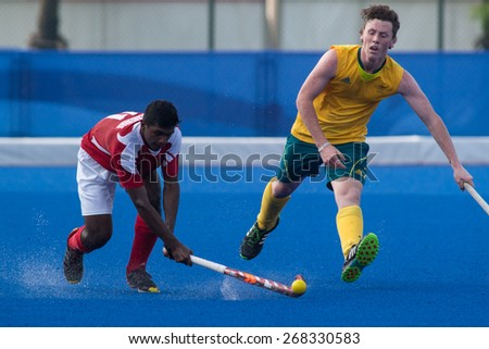 NANJING, CHINA-AUGUST 21: Canada Hockey Team (red) plays against Australia Hockey Team (yellow) during Day 5 match of 2014 Youth Olympic Games on August 21, 2014 in Nanjing, China.