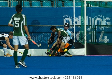 NANJING, CHINA-AUGUST 21: Fynn Edwards (goalkeeper) of New Zealand Hockey Team defends the goal during Day 5 match against Pakistan at 2014 Youth Olympic Games on August 21, 2014 in Nanjing, China. - stock photo