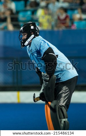NANJING, CHINA-AUGUST 21: Fynn Edwards, goalkeeper of New Zealand Hockey Team during Day 5 match against Pakistan at 2014 Youth Olympic Games on August 21, 2014 in Nanjing, China. - stock photo
