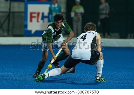 NANJING, CHINA-AUGUST 21: Pakistan Hockey Team (Green) plays against New Zealand Hockey Team (white) during Day 5 match of 2014 Youth Olympic Games on August 21, 2014 in Nanjing, China.