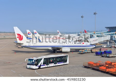 NANJING-MAY 27, 2014. Parked airplanes at Nanjing Lukou International Airport which consists of two terminals, two 3600m runways, two control towers, cargo center, transportation center and apron.
