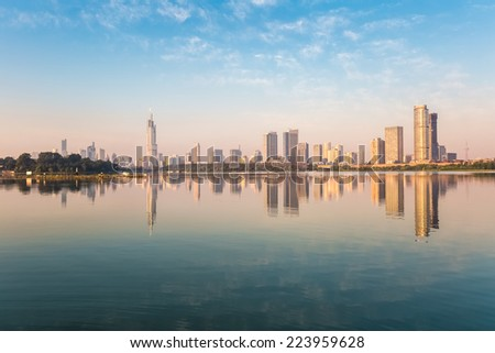 nanjing skyline and xuanwu lake with the morning sun shining   - stock photo