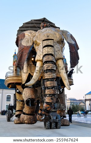NANTES, FRANCE - CIRCA DECEMBER 2009: The Great Elephant goes for a walk with passengers aboard. - stock photo