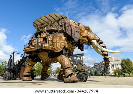 NANTES, FRANCE - CIRCA SEPTEMBER 2015: The Great Elephant goes for a walk with passengers aboard. - stock photo