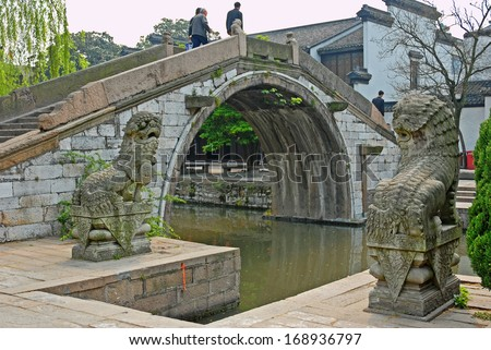 NANXUN, SHANGHAI, CHINA -Â?Â? APRIL 11: famous old bridge and beautiful stone dragons. The Nanxun water town is Shanghai tourist attraction with 100000 visitors year. April 11, 2007,Nanxun, China