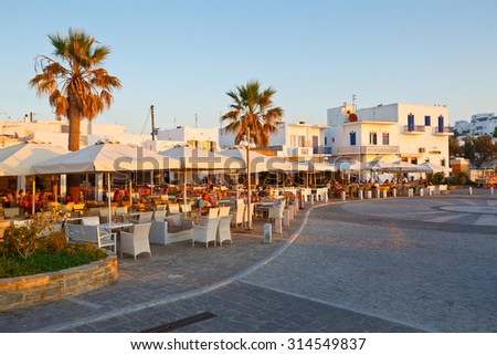 Naousa, Greece - September 03 2015: Coffee shops on the seafront in the harbour of Naousa village on Paros island, Greece