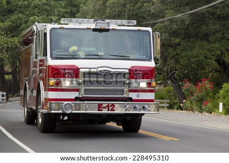 NAPA VALLEY, CA - APRIL 14: Napa County fire truck in Yountville on April 14, 2014. There are 1,781 fire departments and fire stations in California  - stock photo
