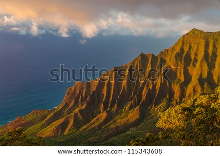 Napali coast in the evening sunlight at Kauai. View from Kalaulau lookout - stock photo