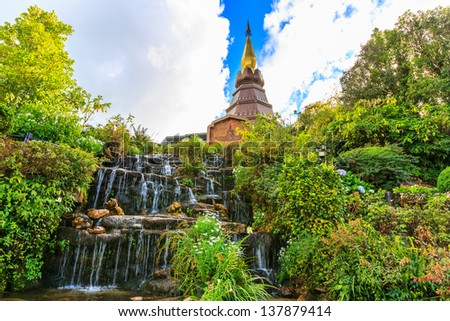 Naphapholphumisiri che-di with man made water fall, doi inthanon national park, chiang mai, thailand.