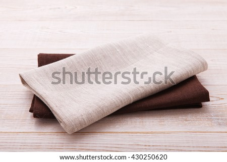 Napkin. Cloth napkin in perspective on white wooden background.Top view, mock up.