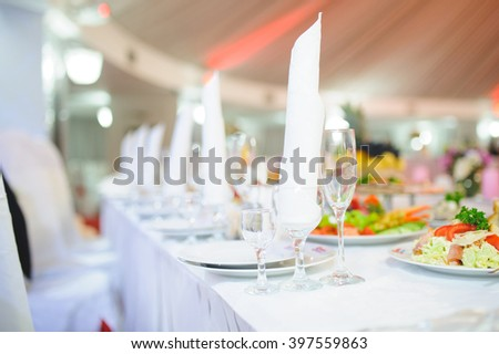 napkin in empty glass on table