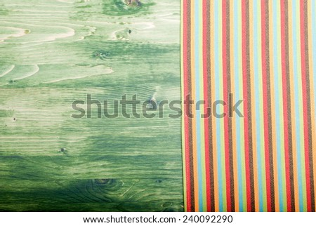 napkin on a green chalkboard on the right, the left space for text - stock photo