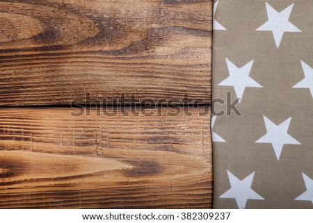 Napkin on old wooden burned table or board for background.