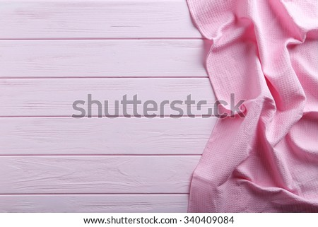Napkin on pink wooden table, close up - stock photo