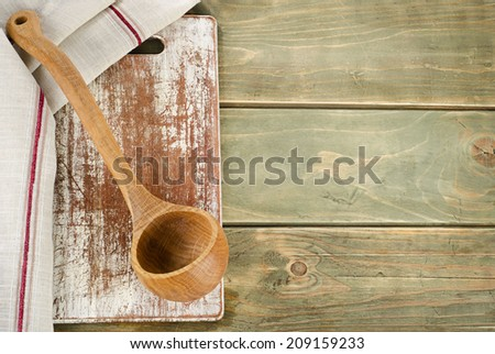 Napkin with wooden spoon on a  wooden table