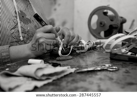 NAPLES - DECEMBER 17, 2013: a traditional laboratory for the production of shoes in Materdei, Naples