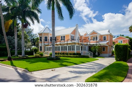 Naples, Florida USA - July 28, 2015: Beautiful vintage wood frame architecture style home in the coastal residential historic district of Naples. - stock photo