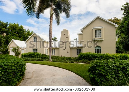 Naples, Florida USA - July 28, 2015: Unique stucco architecture style home in the coastal residential historic district of Naples. - stock photo