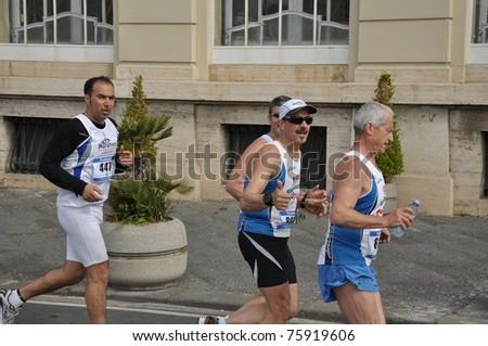 NAPLES, ITALY - APRIL 18: unidentified runners at the XIV Neapolis Half Marathon on April 17, 2011 in Naples - stock photo