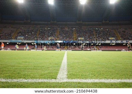 NAPLES, ITALY- AUGUST 2, 2014:  Wide view of the game and the stadium during the friendly match Napoli vs Paok. Focus on the line, shallow depth of field.