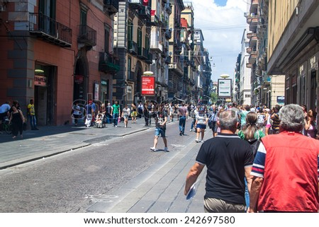 NAPLES, ITALY- JULY 1, 2014: Street in historic center of Naples, Italy. Naples historic city center is the largest in Europe, and is listed by UNESCO as a World Heritage Site.