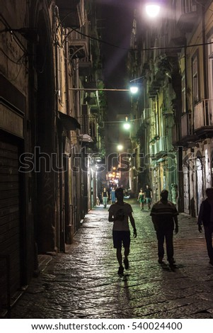 NAPLES, ITALY- JUNE 30, 2014: Night view of a street in historic center of Naples, Italy. Naples historic city center is the largest in Europe, and is listed by UNESCO as a World Heritage Site.