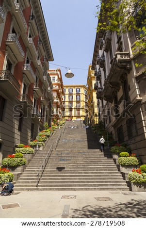 NAPLES, ITALY - MAY 22, 2014: Classical romantic small street in the historical center of Naples, Italy. Naples is the the third-largest city in Italy with about 1 million residents - stock photo