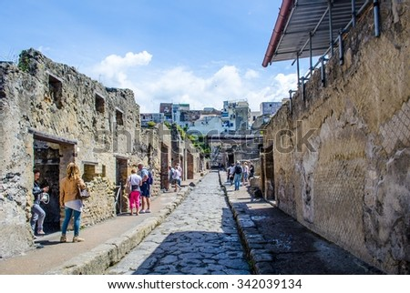 NAPLES, ITALY, MAY 14, 2014: ruins of herculaneum destroyed by vesuvius volcano are less famous than ruins of pompeii, but nevertheless they also create compact area of former buildings - stock photo
