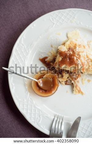 Napoleon cake with caramel on a plate