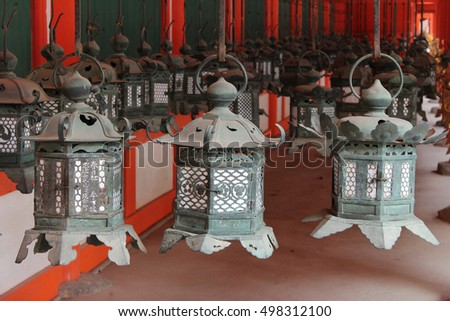 Nara, Japan - April 22, 2016: Detail of a row of ornate bronze lanterns as the famous point of Kasuga Grand Shrine