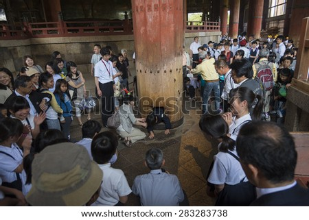 NARA, JAPAN - MAY 16: Tourists visit Todai-ji temple on May 16, 15 in Nara. It is a Buddhist temple complex which houses the world's largest bronze statue of the Buddha Vairocana (Daibutsu).