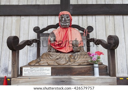 NARA, JAPAN - NOV 26, 2012: Binzuru Pindola wooden statue in Todai-ji Temple, Nara, Japan. Japanese believed that when a person rubs a part of this statue, his ailment there will disappear.