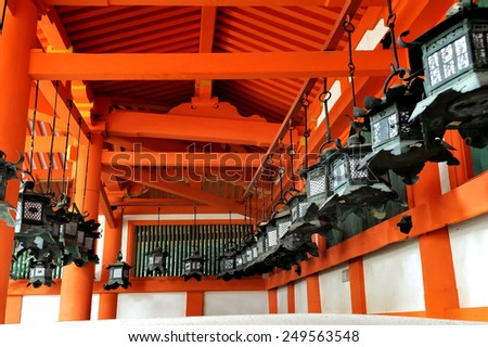 NARA,JAPAN-NOVEMBER 6, 2014;Kasuga Taisha Shrine is famous for its lanterns,   Bronze lanterns are hanging from the buildings .It is an UNESCO World Heritage site.November 6, 2014 Nara, Japan - stock photo
