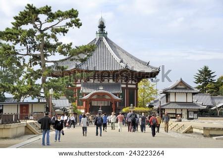 NARA, JAPAN-NOVEMBER 6, 2014; Tourists at the Northern Octagonal Halls of Kofukuji temple.This is an Unesco World Heritage site. November 6, 2014 Nara, Japan - stock photo