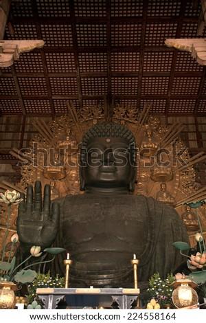 NARA, JAPAN - SEPTEMBER 15: Great Buddha at Todai temple at September 15, 2014, Nara, Japan. The great Buddha of Nara is said to be more than 500 years old. - stock photo