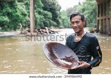 NARATHIWAT,THAILAND - JULY 23: Gold panning activity in river at southern Thailand. This river  located in Narathiwat, July 23, 2015.